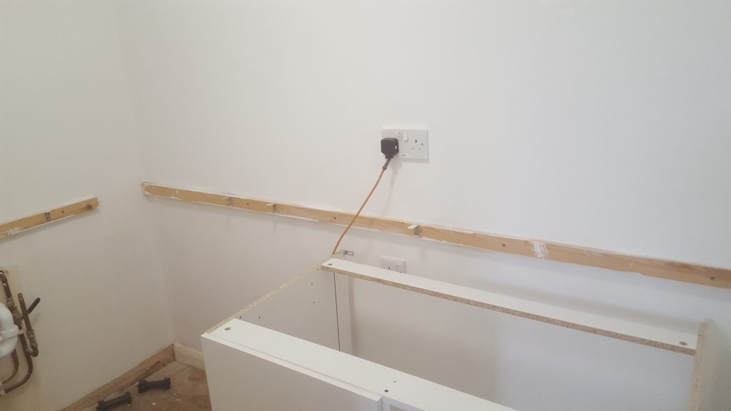 Fitting Kitchen Units On Uneven Walls, How To Fix Kitchen Units Plasterboard Wall